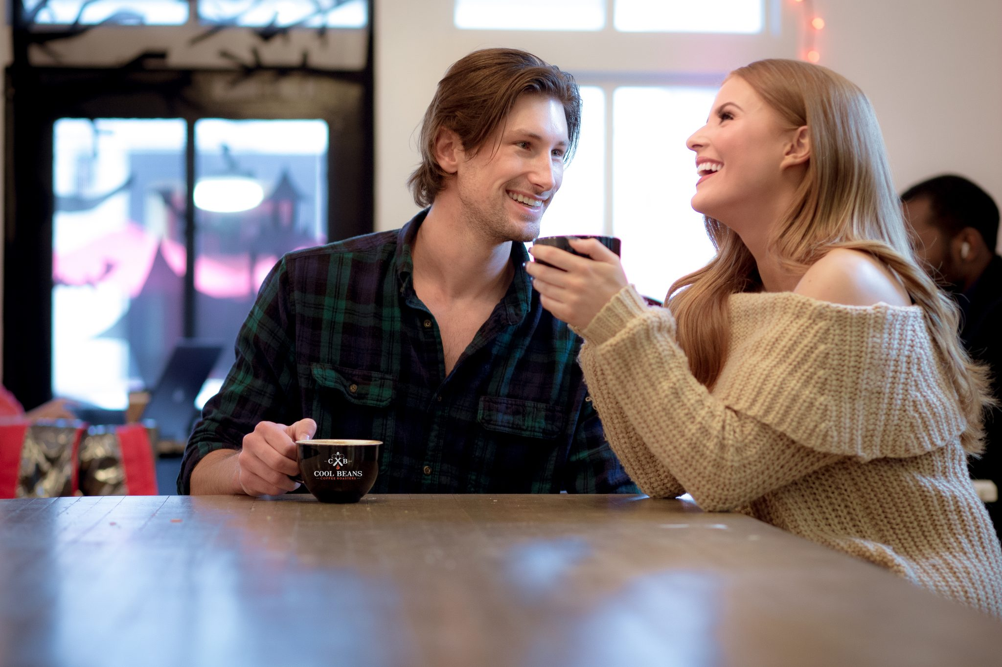 couple staying warm in a coffee house